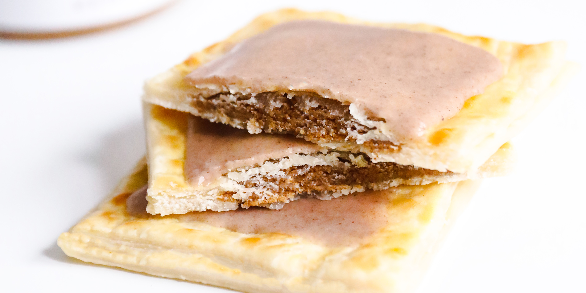 Brown Sugar Cinnamon Almond Butter Toaster Pastries stacked on top of each other on a white background