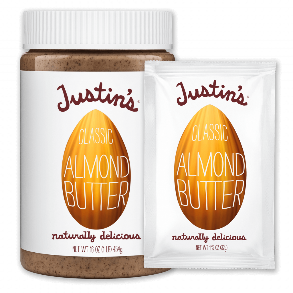 Justin's Classic Almond Butter Spread jar 16 oz. beside Justin's Classic Almond Butter Spread Squeeze Pack 1.15 oz.