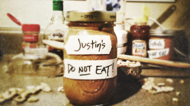 """Mason jar with a taped label that says, """"Justin's Do not eat!"""""""