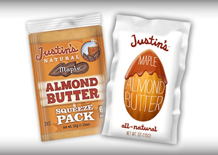 Old and new packaging of Justin's Maple Almond Butter spread squeeze pack 1.15 oz beside each other