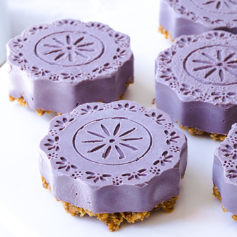 Plant-Based Peanut Butter Blueberry Cheesecakes (close up) placed on a white background (thumbnail)