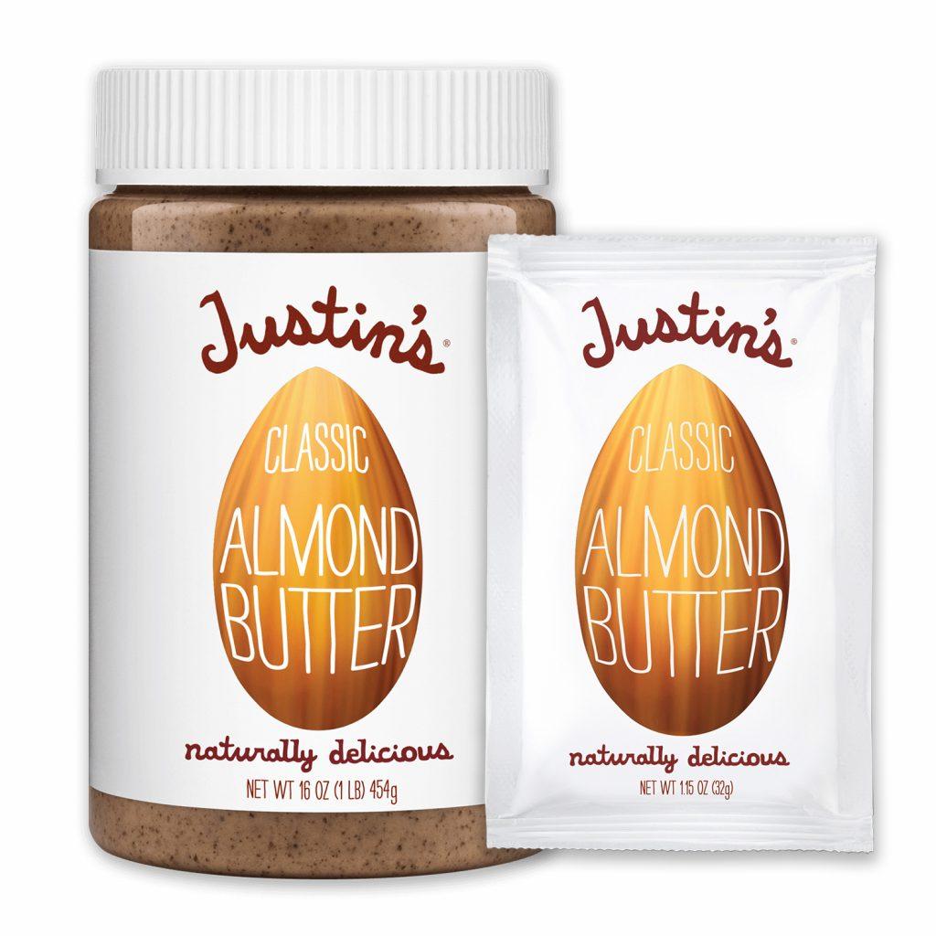 Justin's Classic Almond Butter Spread jar 16 oz. beside Justin's Classic Almond Butter Spread Squeeze Pack 1.15 oz.